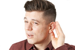 Young Man Suffering With Hearing Difficulties Stock Image