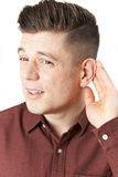 Young Man Suffering With Hearing Difficulties Stock Images