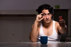 The young man suffering at home night time. Young man suffering at home night time stock images