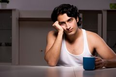 The young man suffering at home night time. Young man suffering at home night time stock photos