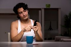 The young man suffering at home night time. Young man suffering at home night time royalty free stock photo