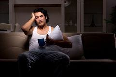 The young man suffering at home night time. Young man suffering at home night time royalty free stock photos