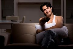 The young man suffering at home night time. Young man suffering at home night time royalty free stock images