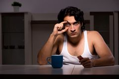 The young man suffering at home night time. Young man suffering at home night time royalty free stock image