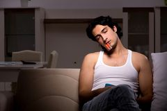Young man suffering at home night time. The young man suffering at home night time royalty free stock photo