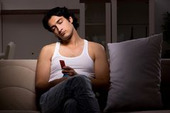 The young man suffering at home night time. Young man suffering at home night royalty free stock image