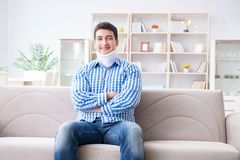 Young man suffering a neck spine head trauma wearing a cervical Stock Image