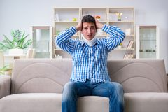 Young man suffering a neck spine head trauma wearing a cervical Royalty Free Stock Image