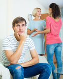 Young man suffering of scandals between family members Stock Photo