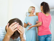 Young man suffering of scandals between family members Royalty Free Stock Photo