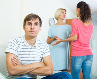 Young man suffering of scandals between family members Stock Photos