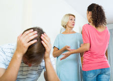 Young man suffering of scandals between family members Royalty Free Stock Image