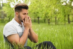 Young man suffering from seasonal allergy outdoors on sunny day. Space for text stock photos