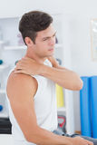 Young man suffering from shoulder pain Royalty Free Stock Photos