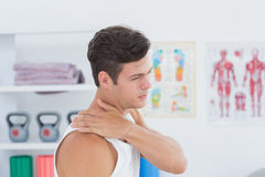 Young man suffering from shoulder pain Stock Images