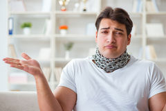 The young man suffering from sore throat Stock Photography