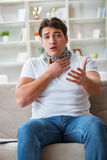 The young man suffering from sore throat Stock Images