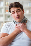 The young man suffering from sore throat Royalty Free Stock Photography