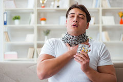 The young man suffering from sore throat. Young man suffering from sore throat Royalty Free Stock Photography