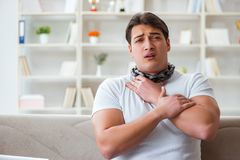 The young man suffering from sore throat Stock Photo