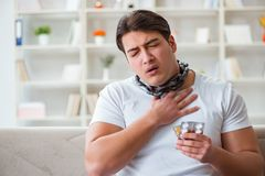 The young man suffering from sore throat Royalty Free Stock Images