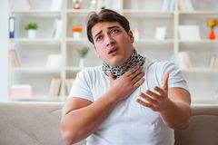 The young man suffering from sore throat Royalty Free Stock Image
