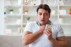 The young man suffering from sore throat. Young man suffering from sore throat Stock Photos