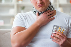 The young man suffering from sore throat Stock Image