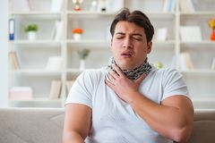 The young man suffering from sore throat. Young man suffering from sore throat Royalty Free Stock Photo