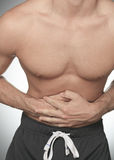 Young man suffering from stomach ache Royalty Free Stock Photo