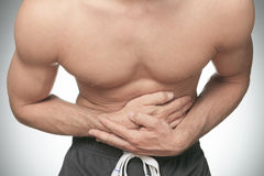 Young man suffering from stomach ache Royalty Free Stock Images