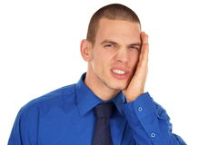 Young man suffering from a toothache. Royalty Free Stock Photo