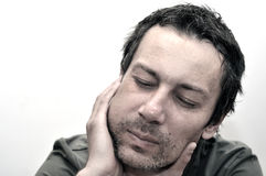 Young man suffering from toothache, teeth pain, having a swollen Royalty Free Stock Images