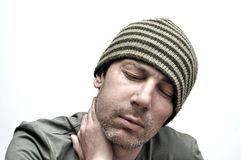 Young man suffering from toothache, teeth pain, having a swollen Royalty Free Stock Image