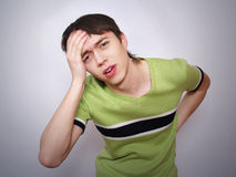 Young man suffers from a headache Royalty Free Stock Images