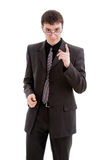 A young man in a suit. A young man in a suit, glasses and tie, threatening finger, isolated on a white background Stock Photos