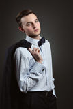 Young man with suit and bow tie Royalty Free Stock Image