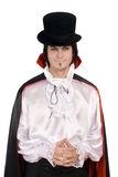 Young man in a suit of Count Dracula. Smiling young man in a suit of Count Dracula Royalty Free Stock Image