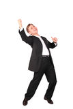 Young man in suit dancing stock image