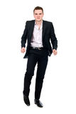 Young man in suit dancing. Royalty Free Stock Photos