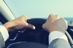 Young man in suit driving a car, filtered Royalty Free Stock Photography