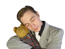 The young man in a suit, embracing a toy bear Stock Photo