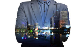 Young man in suit and with folded arms on abstract illuminated n Royalty Free Stock Photo