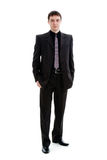 A young man in a suit, in full-length. Royalty Free Stock Photo