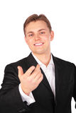 Young man in suit gesture hand forward Royalty Free Stock Images