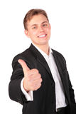 Young man in suit gives gesture Stock Photography