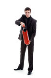 Young man in a suit holding a fire extinguisher. Royalty Free Stock Images
