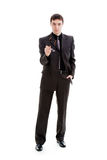 Young man in a suit holding glasses. Young man in a suit holding glasses, isolated on a white background Stock Photography