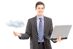 Young man in a suit holding a laptop, symbolizing cloud computing Royalty Free Stock Photography