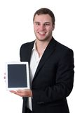 Young man in suit holding tablet pc. Young white man in suit holding white tablet pc and smiling stock images